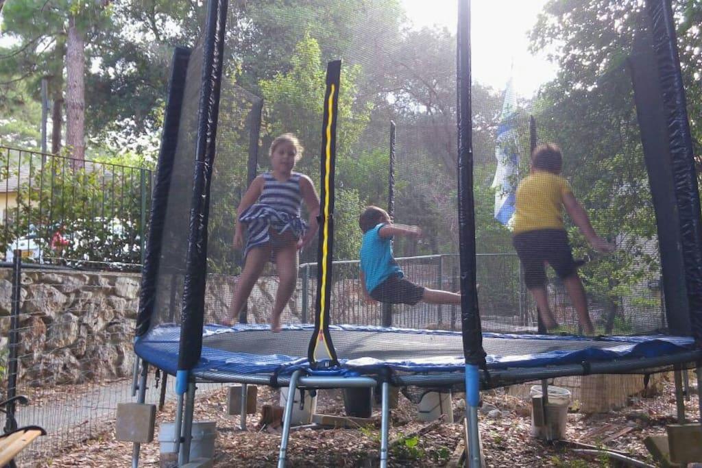 Children enjoying the nearby trampoline.