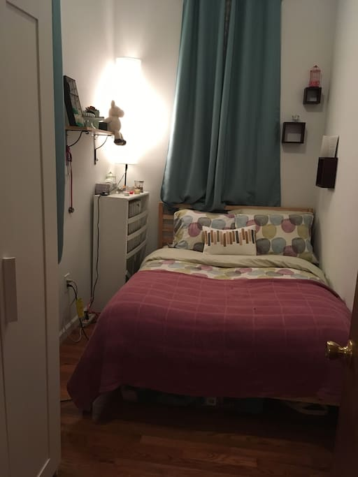 Bedroom with double bed and wardrobe, can fit 1-2 guests
