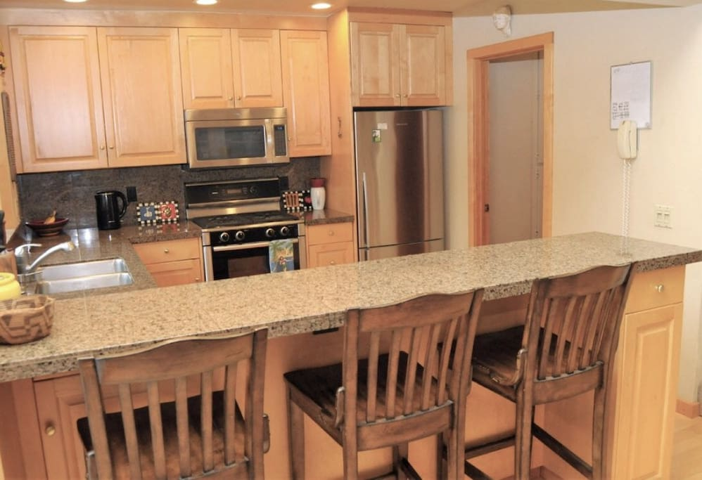 Kitchen with high-end appliances opens to the family and dining room great for entertaining.