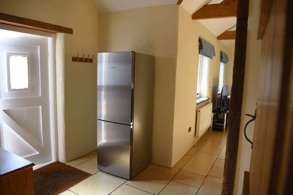 Entrance with large fridge freezer