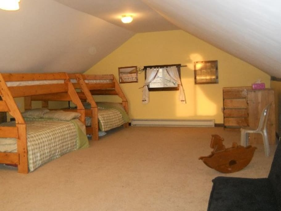 The Loft sleeps 6 in 2 bunk beds, double below and twin above.