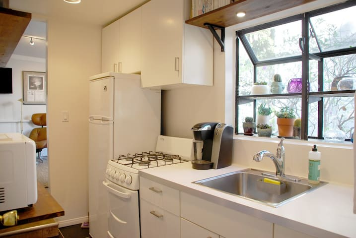 Full kitchen with gas range, refrigerator, microwave. Both Keurig and french press coffee makers - some coffee included in stay.