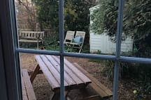 Garden view from study , shed has gardening & beach stuff in .