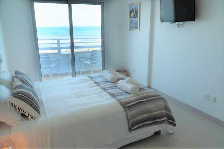 Beachfront modern studio with ocean view balcony