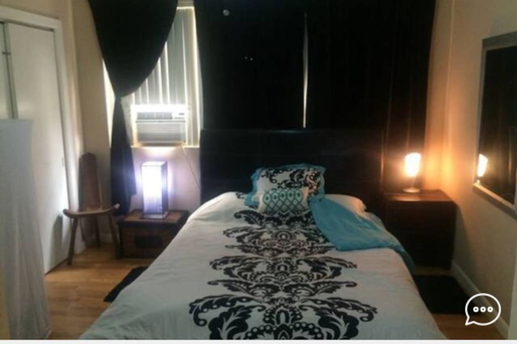 Large bedroom with TEMPUPEDIC queen size mattress and black out curtains.