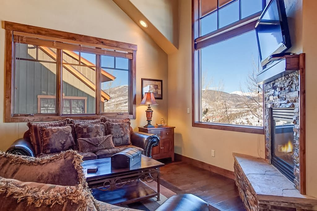 Mountain style throughout, including hardwood floors and a gas fireplace.