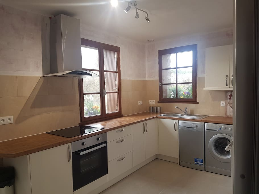 Newly fitted kitchen with induction hob. Oven. Dishwasher, Washing machine and Microwave.