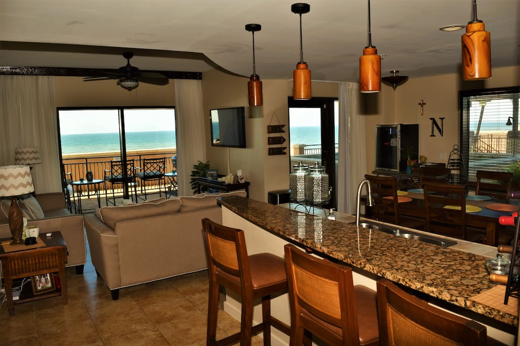 Kitchen, living room  with priceless views. Private gulf front patio.