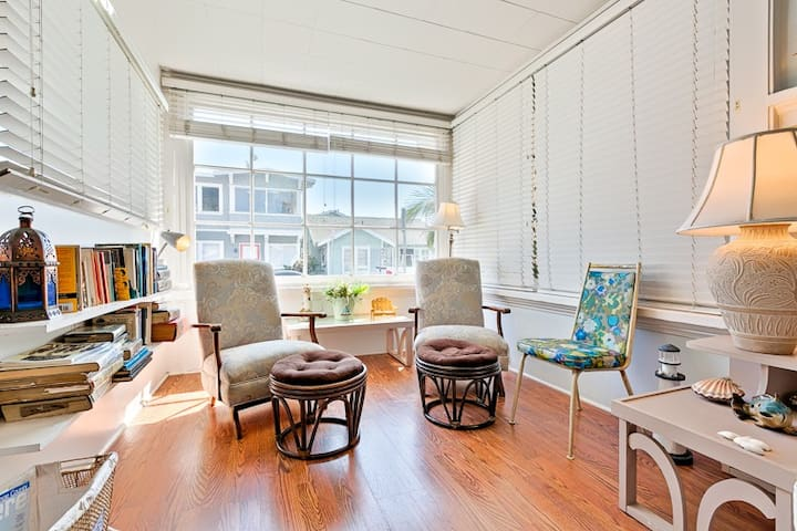 Relax after a day at the beach in this windowed Seating Nook of the Great Room.