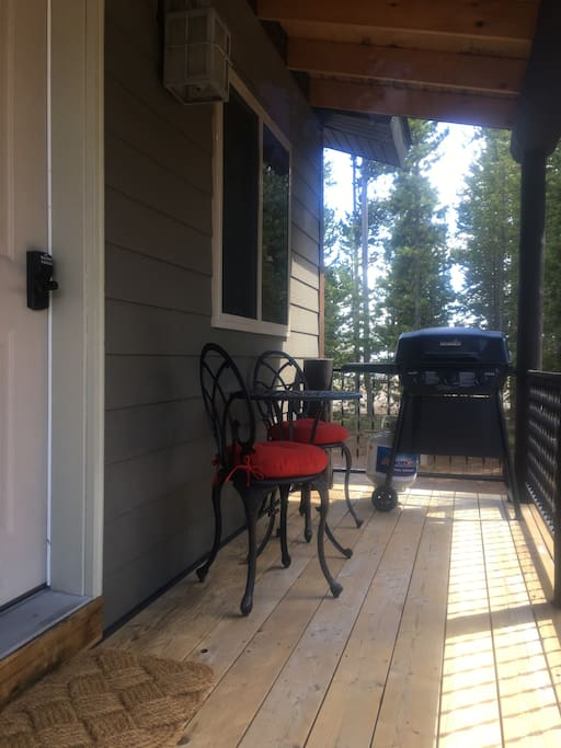 Deck with BBQ and a bistro set