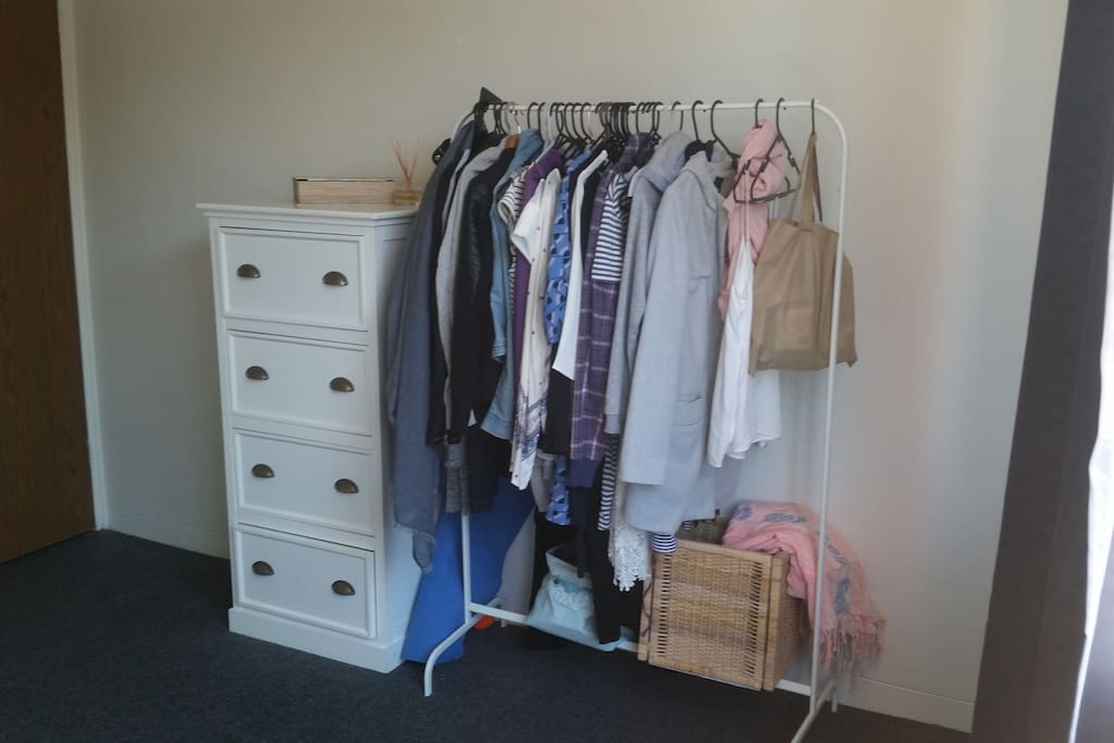 Room has plenty of space to store big suitcases and there are clothes rack and a big drawers as the storage
