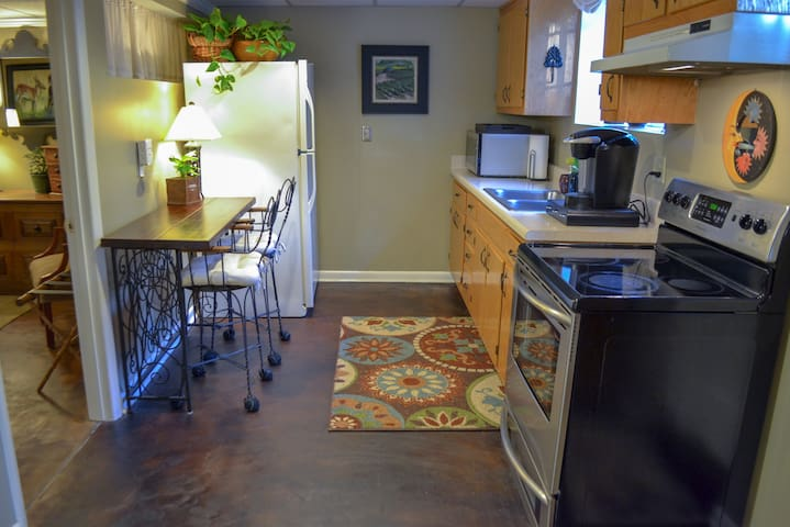 Full-sized refrigerator, updated stove, microwave, and stocked cabinets will meet all your basic kitchen needs