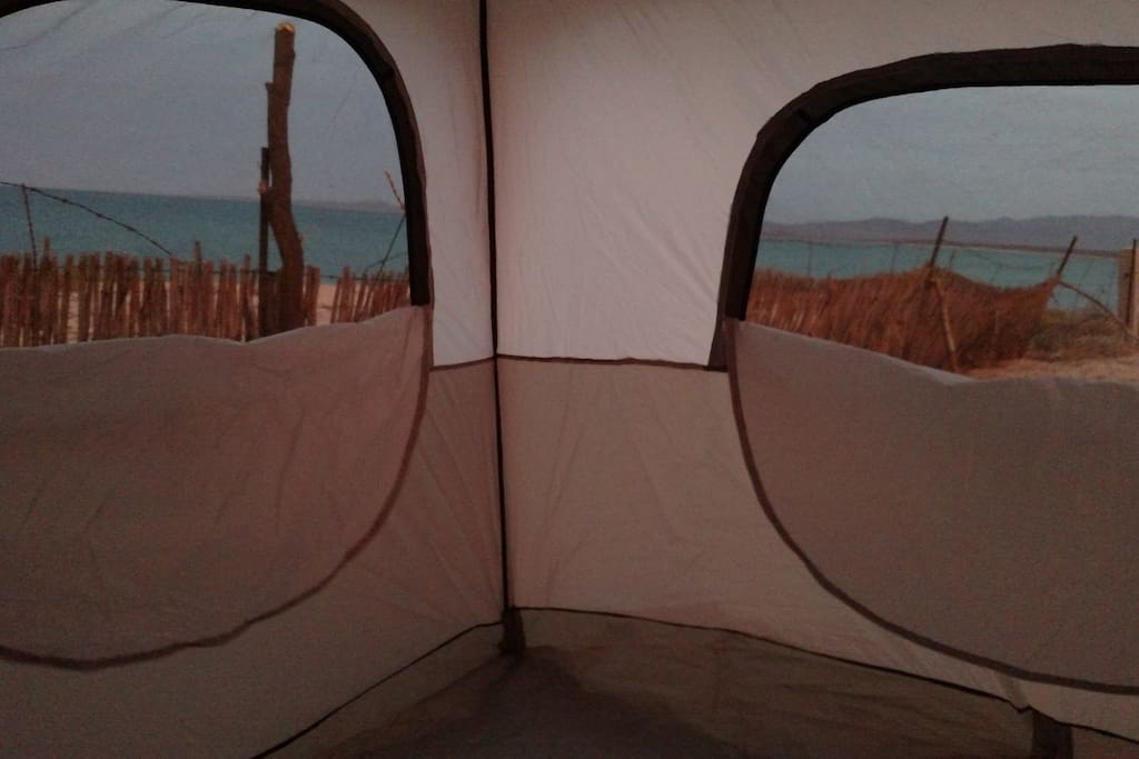 Large windows inside the tent at sunset in December.