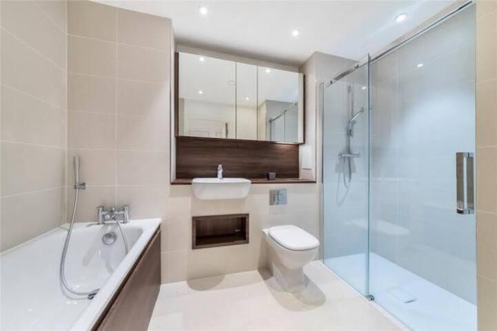 Spacious bath room with both bath and shower available. Heated floors.