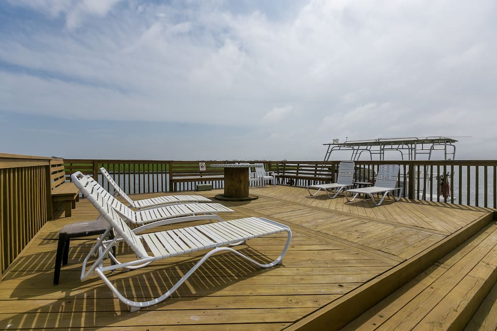 Spacious, waterfront deck beside the pool.