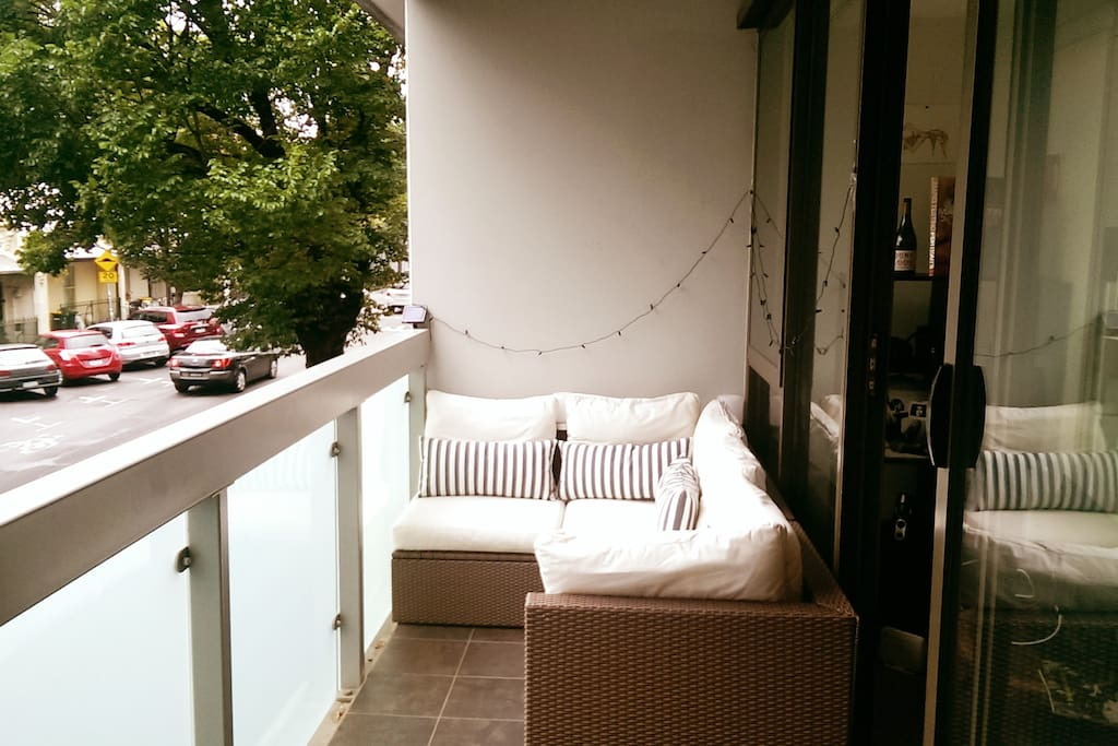 Comfy Ikea outdoor setting on large balcony overlooking beautiful leafy streets of Fitzroy.  Ambient lights come on at night, very relaxing.