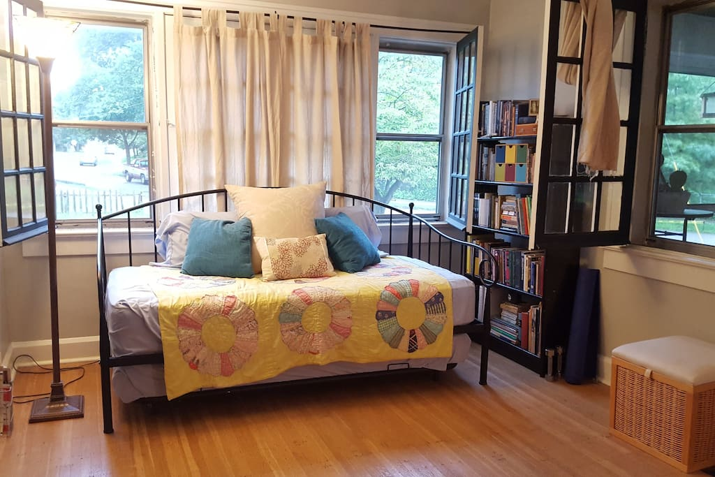 Cozy daybed in the living room adds two more sleeping beds. Snuggle up with a book.