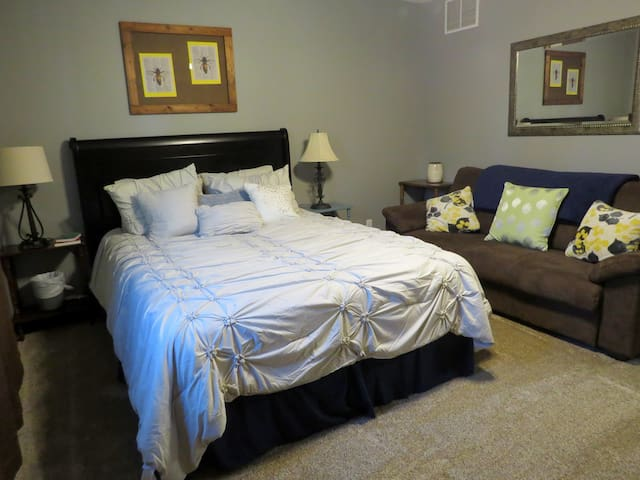 Honey Bee Room, comes with queen size bed, couch, closet, and storage areas.