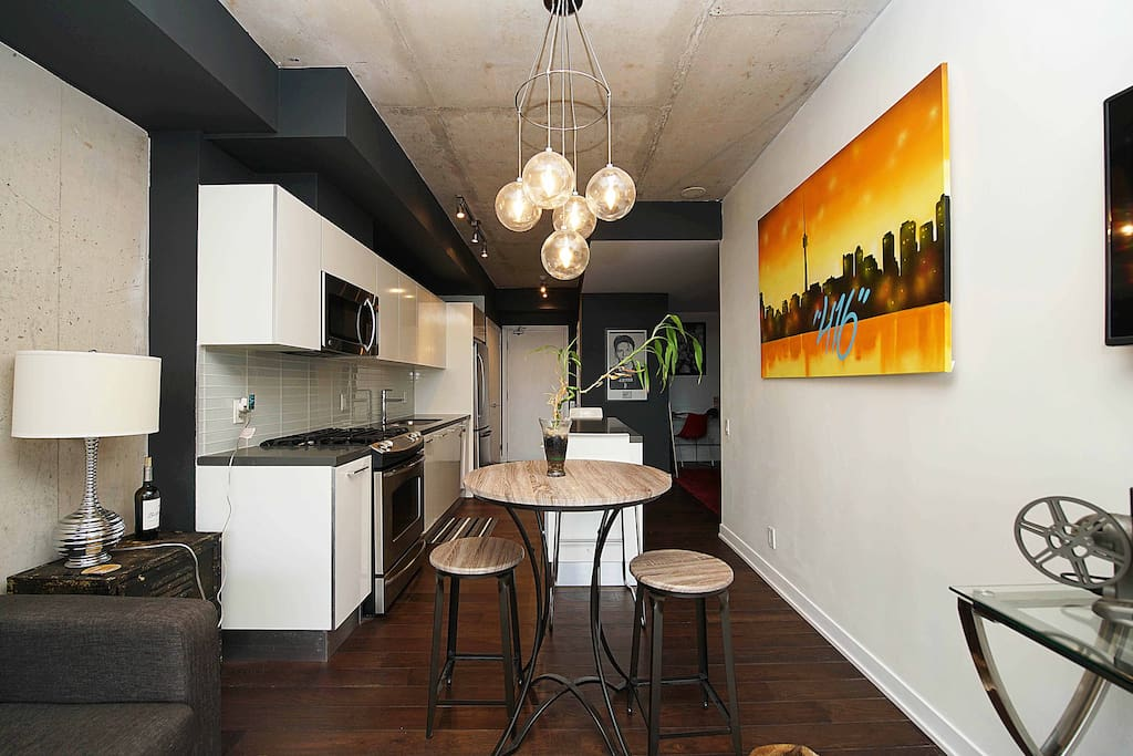 View of kitchen from the living room. Bar table with stools for casual dining