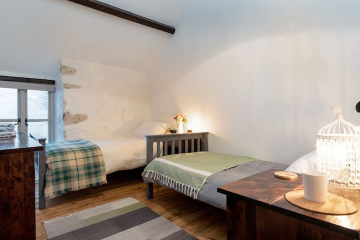 Cosy twin room with adult sized beds and memory foam mattresses