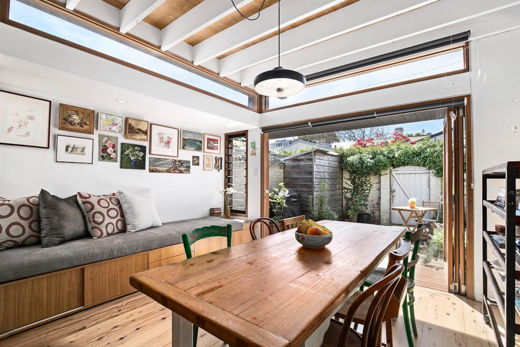 Sunny dining area opens up to rear courtyard