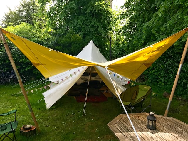 We have added a spinnaker tarp (awning) to our lovely Bell Tent