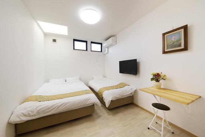 Triple Room with Shared Bathroom
