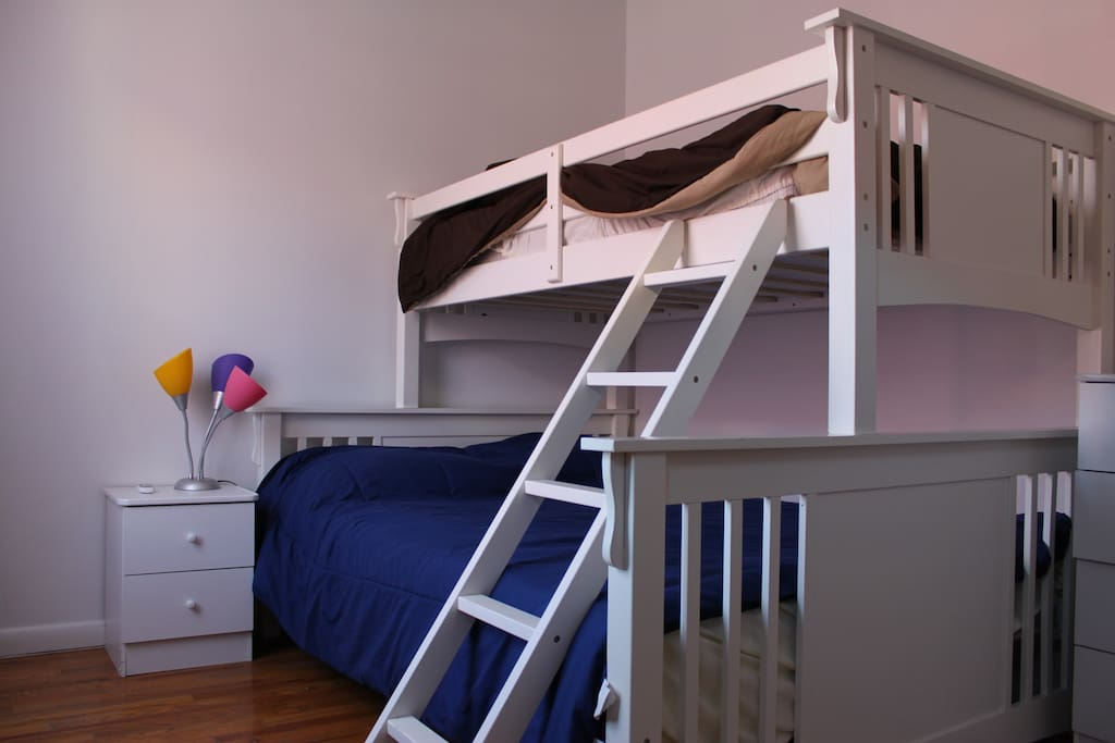 Queen sized bed with Bunk above
