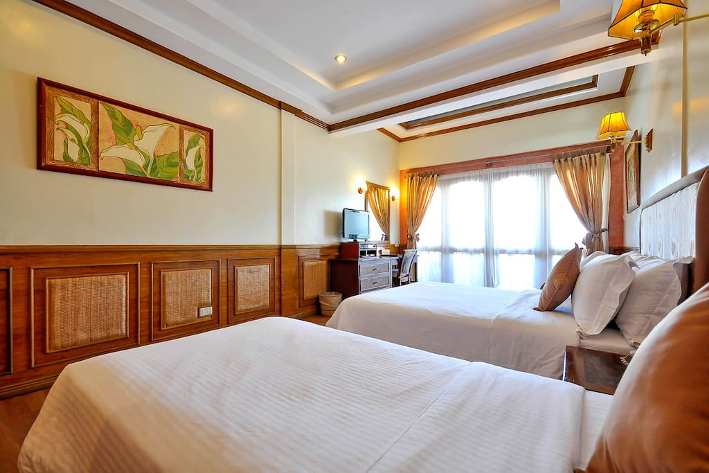 A Premier Room  just steps away from White Beach Station 2.