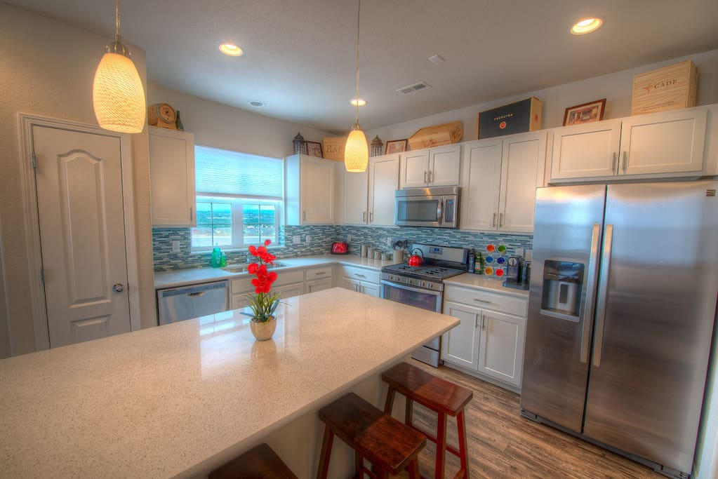 The light and bright kitchen is a natural gathering spot in the house - delicious food brings everyone together!
