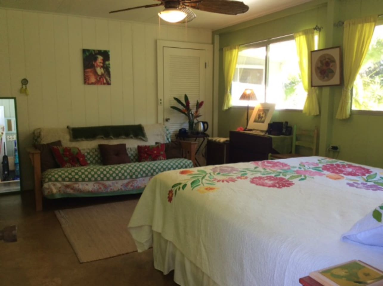 Green Room at papalani farm featuring king size bed and futon.