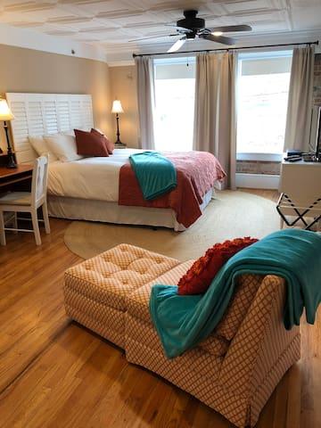Loft Master Suite with room darkening curtains, roller shades, and sound machine
