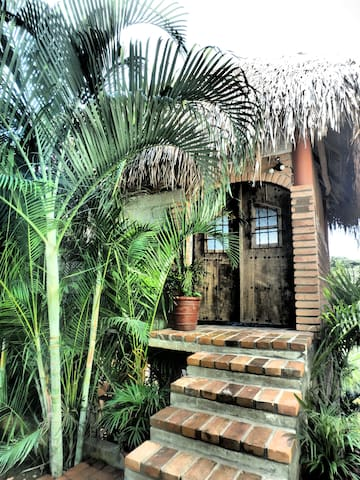 the entrance to the Treehouse. Antique wooden doors give the rustic touch.