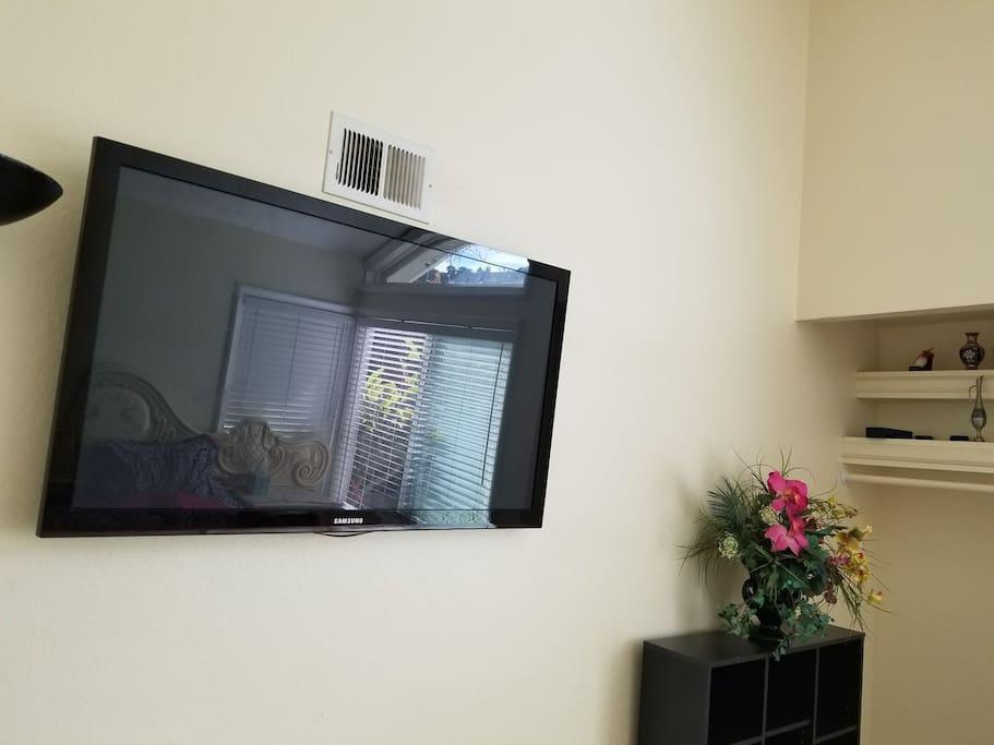 Huge flat screen TV inside private room.