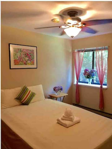 Bedroom #2: Private. Guest room combines neutral and Caribbean color palette to promote relaxation. View from entrance to window.