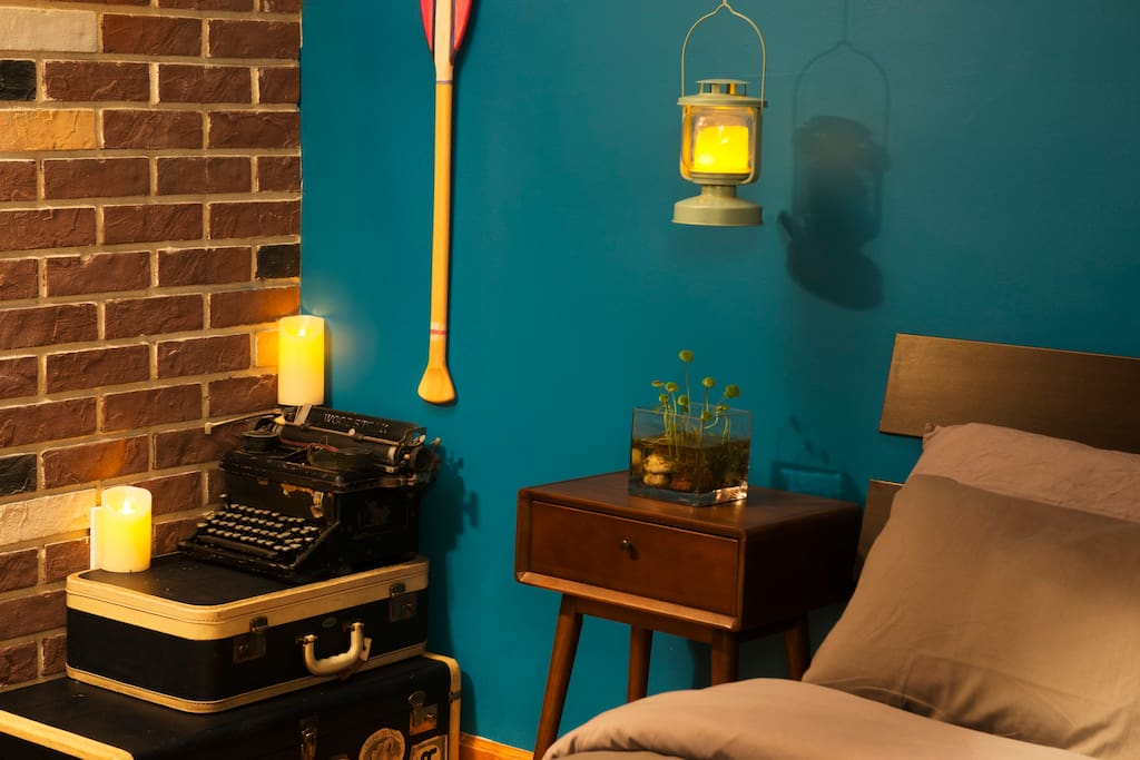 Full Size Bed & Mid-century side table, the paddle is from a fashion video. The 106 year-old vintage typewriter is from the local antique  store