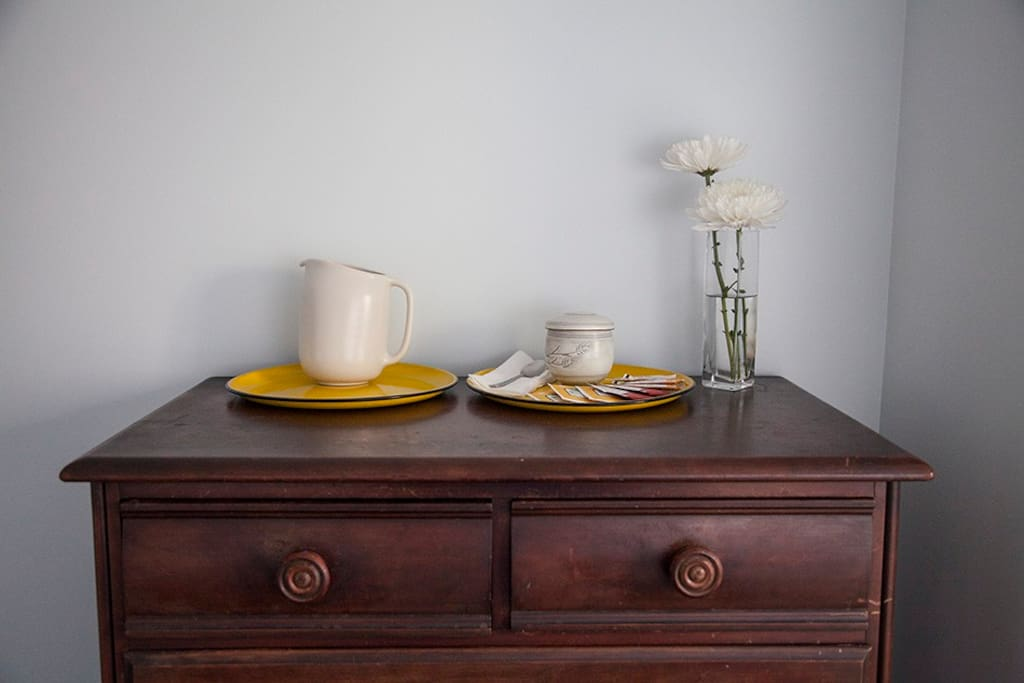 Store your clothes and belongings in this wooden dresser. We always provide a water pitcher, tea cup and assortment of teas for your enjoyment.