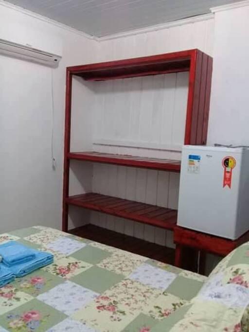 Quarto com frigobar,ar condicionado,net