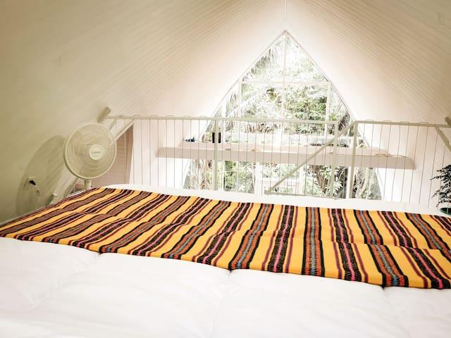 Queen size bed. Zinus green tea mattress.. So comfy! loft bedroom view into jungle