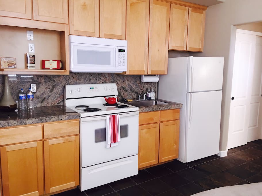 Full wonderful kitchen with oven, microwave, range and fridge....