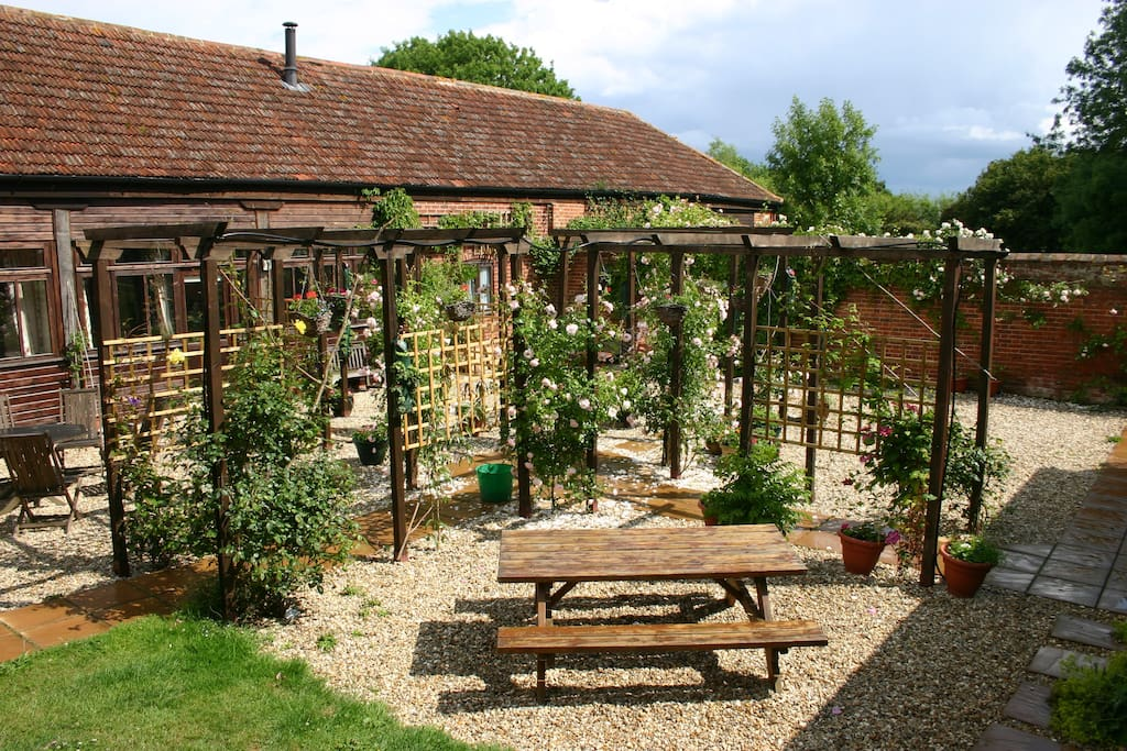 View of garden from barn door. You have your own private seating area within the large courtyard garden.