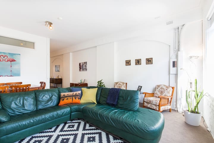 Living/dining room with big tv and comfy couch to relax at