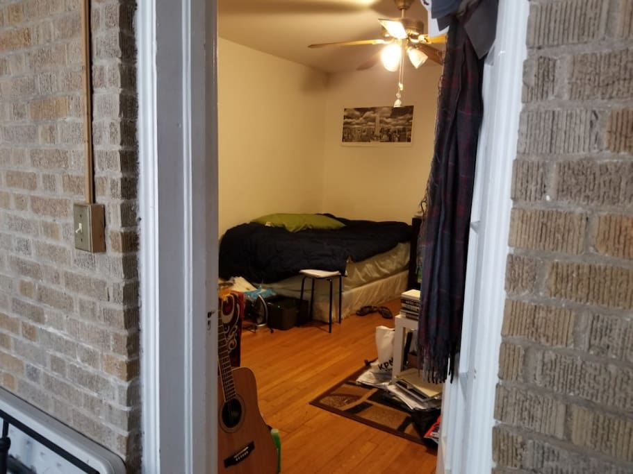 A peek into the room right from the storage space
