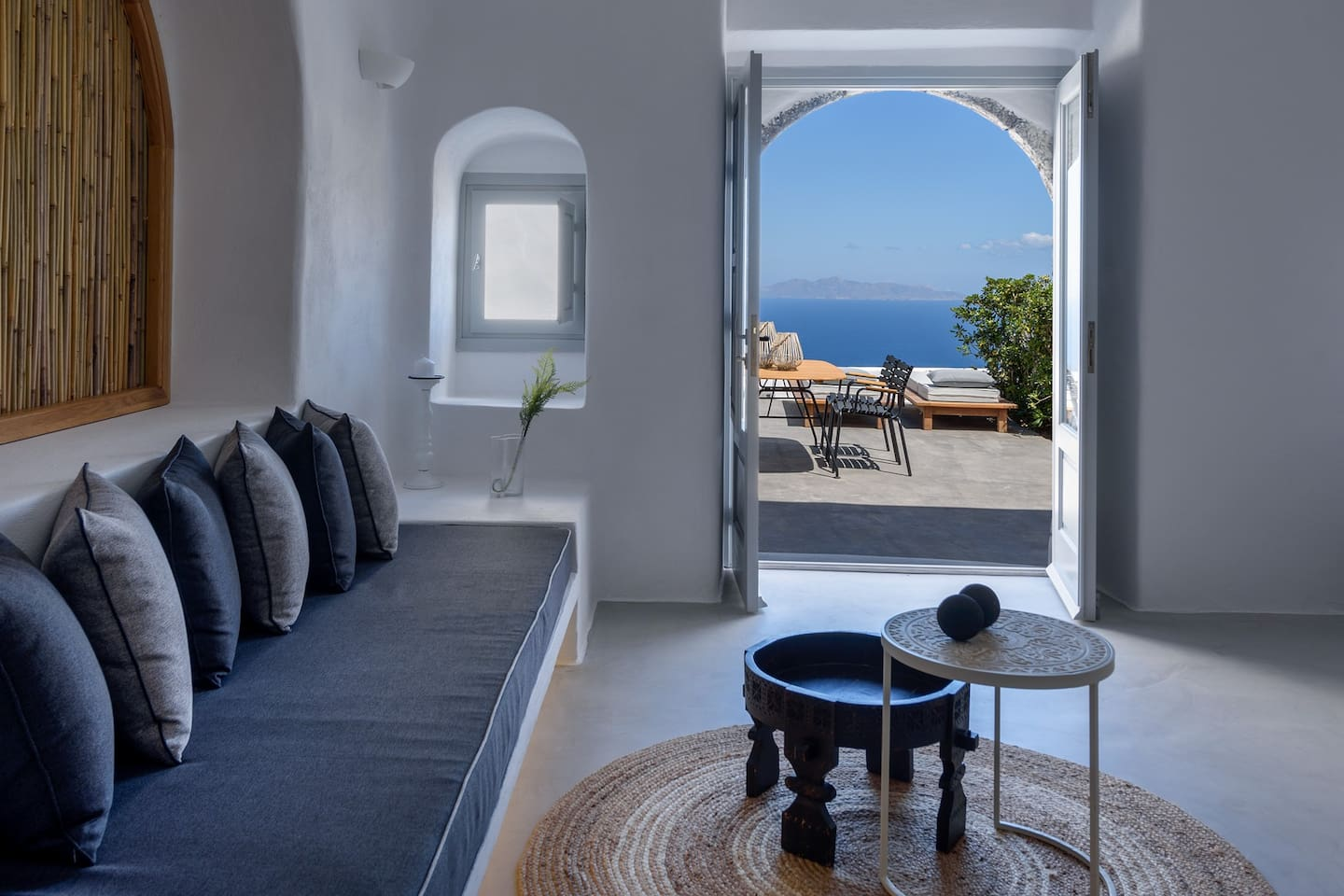 Adele villa with private heated plunge pool ,living room with sea view, teracce with sunbeds and sitting area