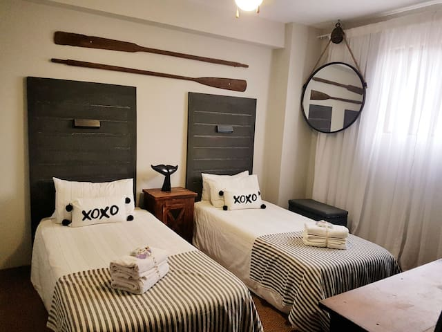Sevond bedroom with twin beds that can be converted to king size bed.
