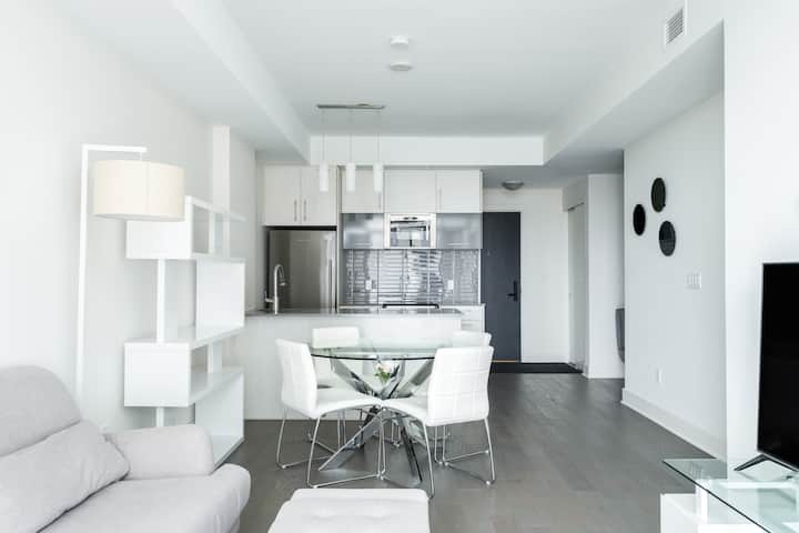 Modern one bed + den Downtown with Indoor Parking