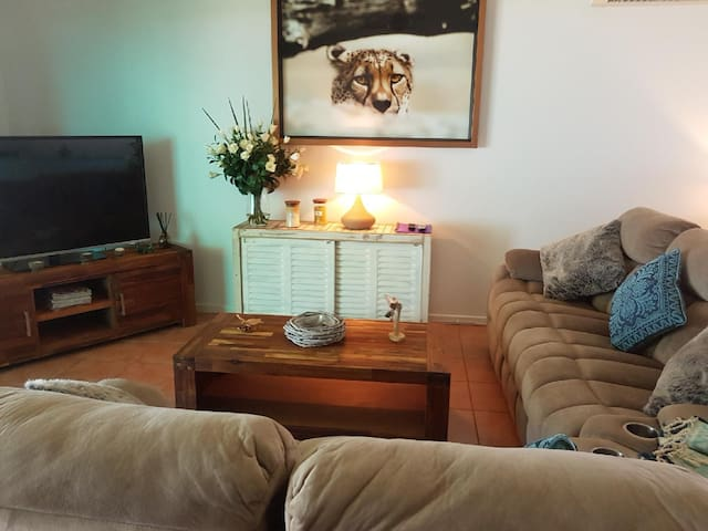 Living Room with large screen TV, DVD library and comfy sofa