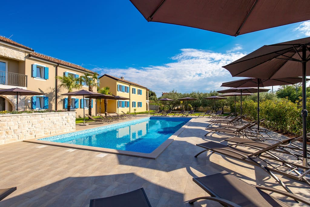 Spacious sun deck with pool