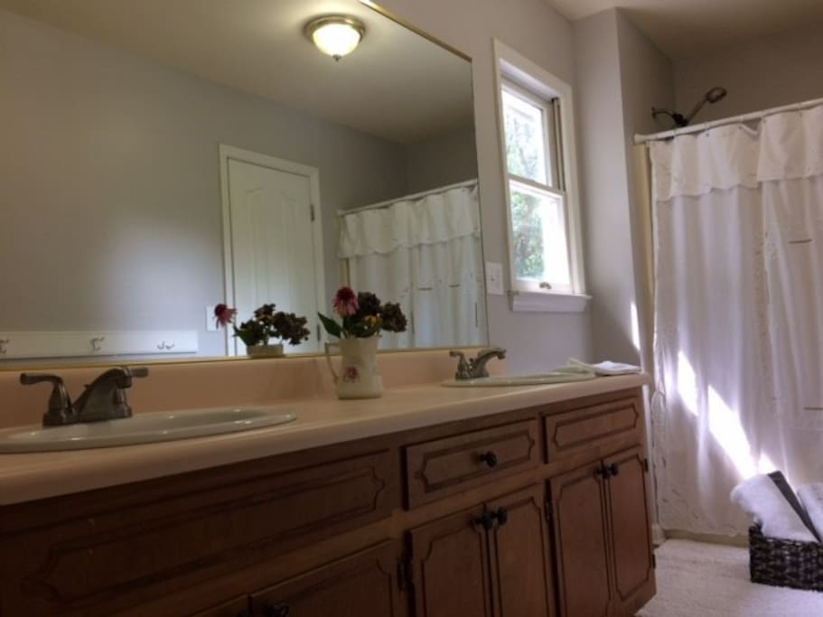 En suite bath with double sinks