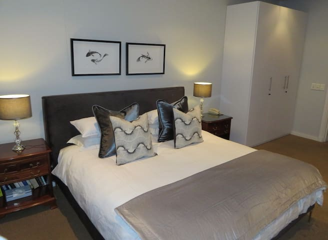 Main bedroom with King extra length bed and bathroom en suite.